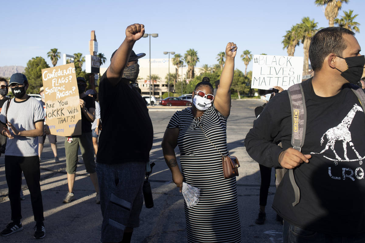 Married couple Kevin Johnson, left, and Angel Johnson, right, both born and raised Las Vegans, ...