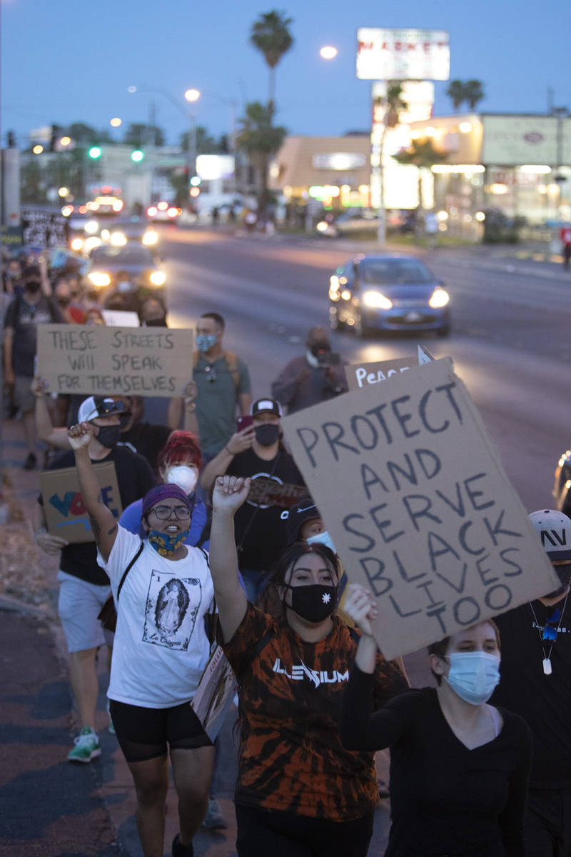 A protest against police brutality moves from Molasky Family Park to the Las Vegas Convention C ...