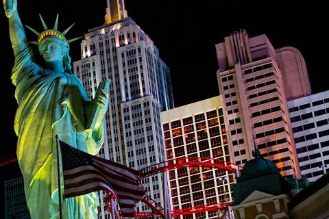 Lights through room windows are displayed at the New York-New York along the Las Vegas Strip on ...
