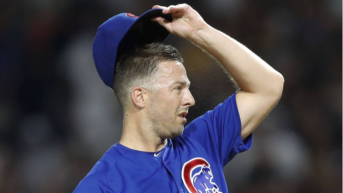 Chicago Cubs relief pitcher Brandon Kintzler reacts after walking Pittsburgh Pirates pinch hitt ...