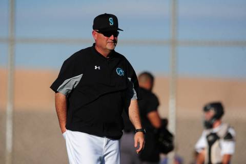 Silverado head coach Brian Whitaker walks to the dugout after making a pitching change in the s ...
