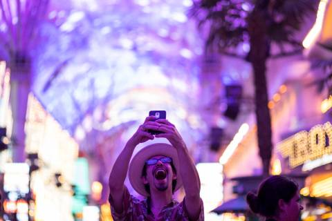 Las Vegas local Jess Medina takes an excited selfie as he visits Fremont Street Experience for ...