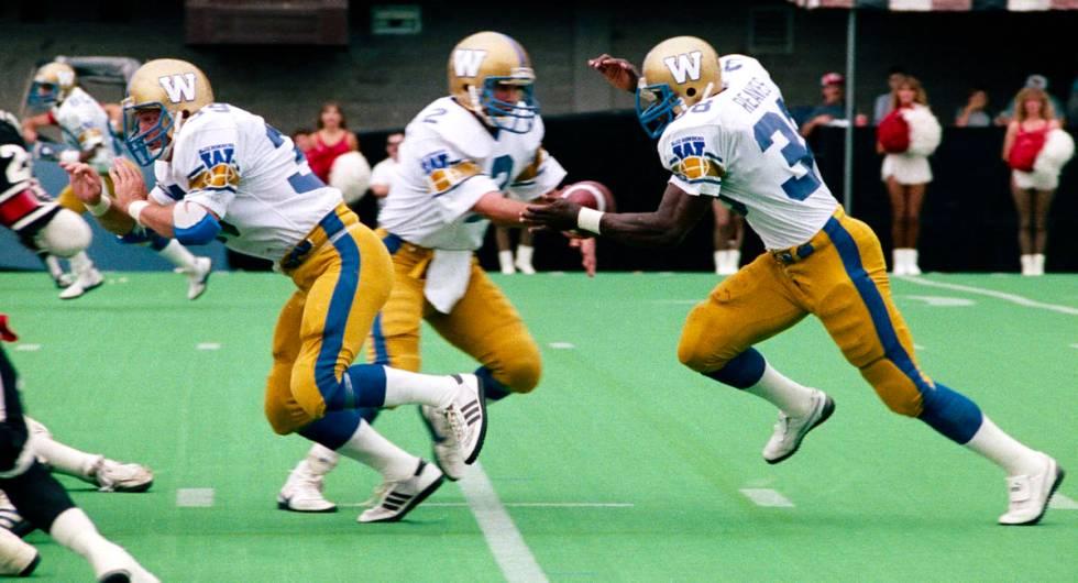 Willard Reeves, right, and Sean Kehoe, Winnipeg Blue Bombers, 1985. (John Bradley)