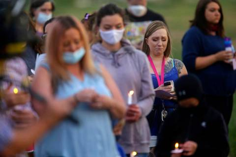 """Visitors listen to """"In the Arms of an Angel,"""" during a memorial service for Tylee Rya ..."""