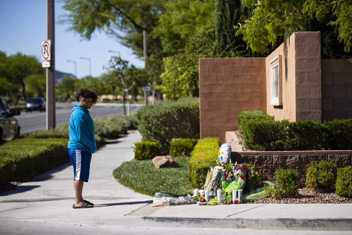 John Taylor, 14, visits the memorial left for David Cox, 18, and Brandon Cox, 14, brothers who ...