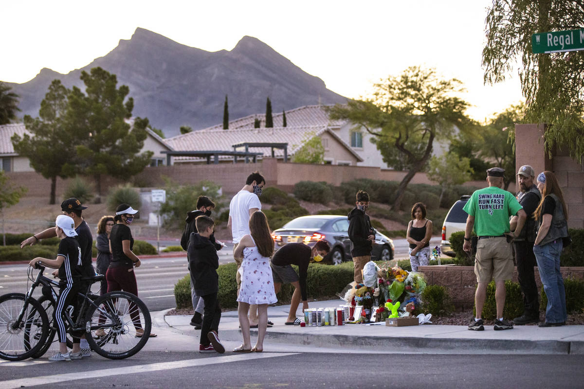People gather for a vigil in memory of David Cox, 18, and Brandon Cox, 14, brothers who were ki ...