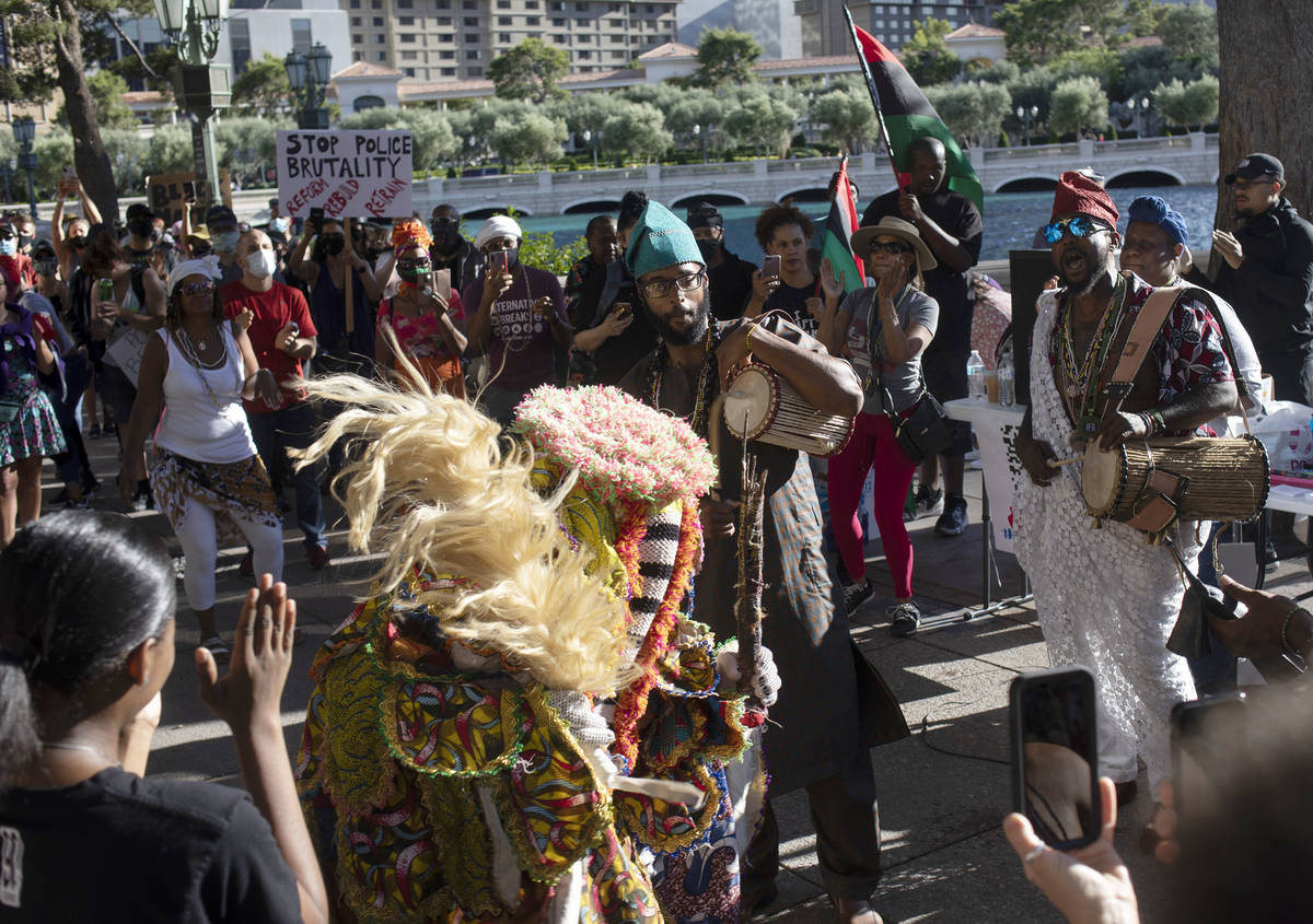 A group performs a traditional Nigerian dance as the protest against police brutality begins ou ...