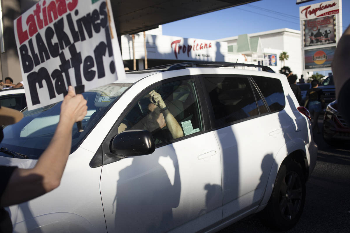During a march against police brutality, protesters move into traffic driving north on Las Vega ...