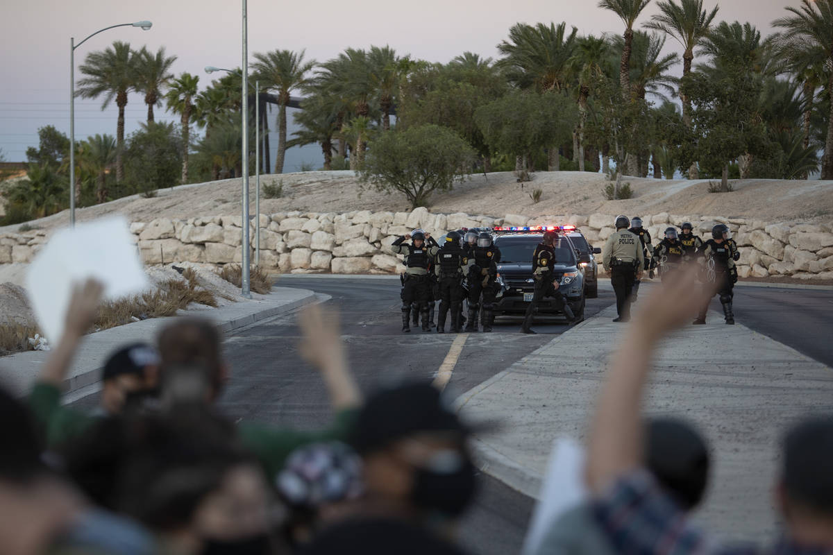 Protesters, who marched against police brutality down Las Vegas Boulevard, are surrounded on tw ...
