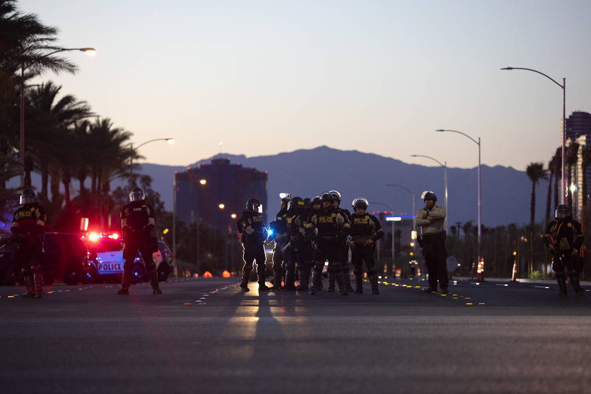 As the last protesters remain, police occupy the intersection of Polaris Avenue and West Russel ...