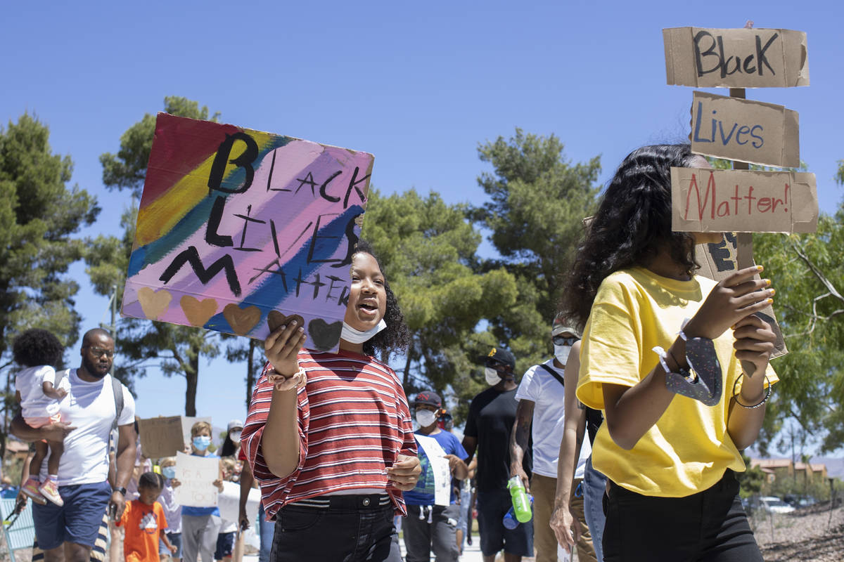 "Ava Rose Turner, left, 8, and Kumei Tenorio-Norwood, right, 11, lead the ""Kids Against Rac ..."