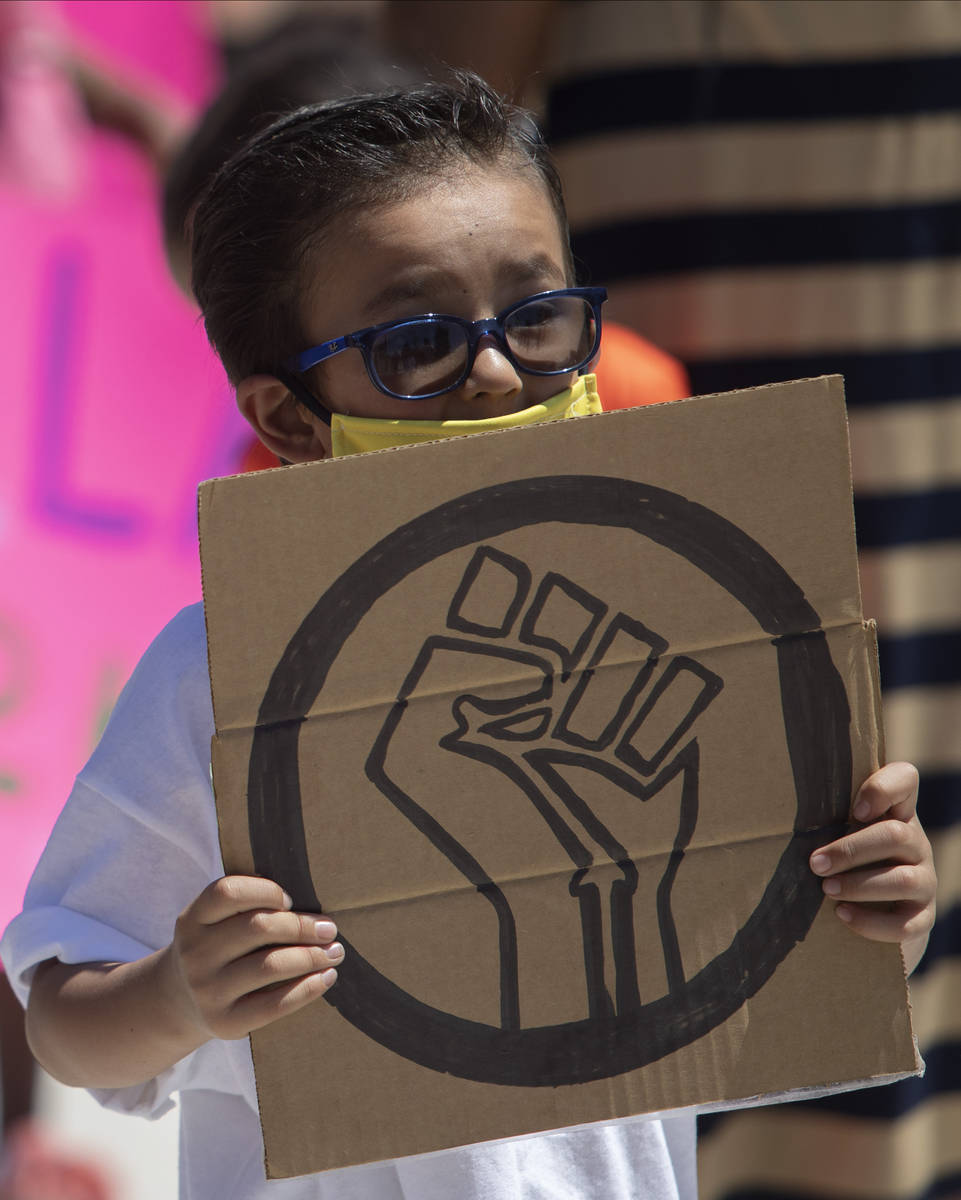 """Benjamin Sanchez, 6, marches in the """"Kids Against Racism Rally"""" at Craig Ranch Region ..."""