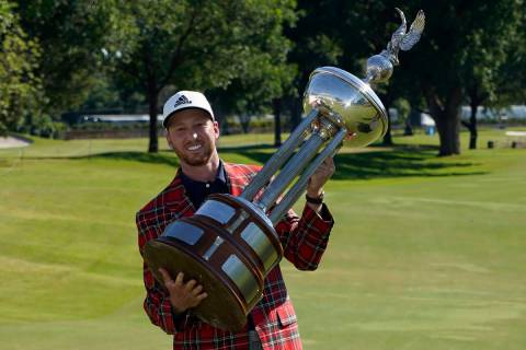 Daniel Berger poses with the championship trophy after winning the Charles Schwab Challenge gol ...