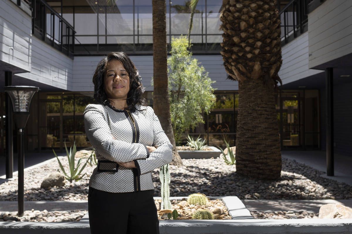 Lydia High, owner of Precise Business Management, stands for a portrait outside her business on ...