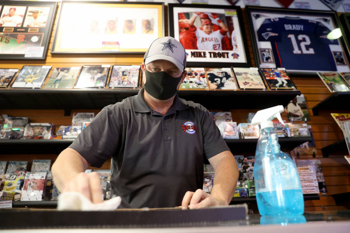 Jeremy Brown, owner of Ultimate Sports Cards and Memorabilia, works in his shop at Neonopolis i ...