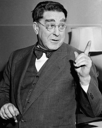 Branch Rickey, president of the Brooklyn Dodgers, pointed a professional finger at his office i ...