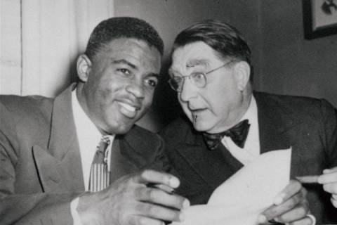 Jackie Robinson, left, Brooklyn Dodgers' second baseman, has a wide smile that almost matches t ...