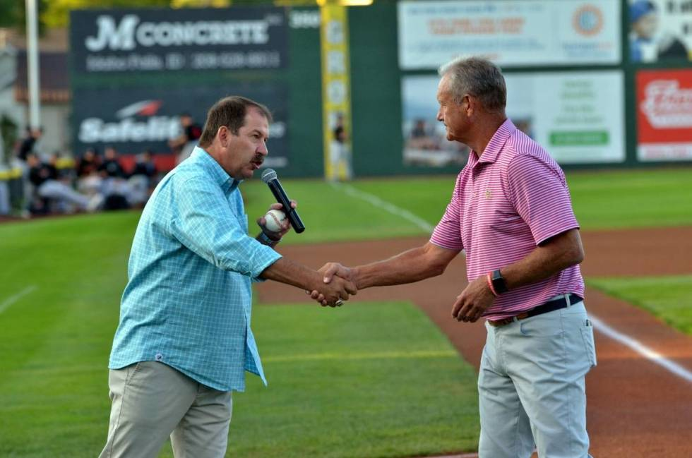 Kevin Greene, general manager of the Pioneer League's Idaho Falls Chukars, shakes the hand of H ...