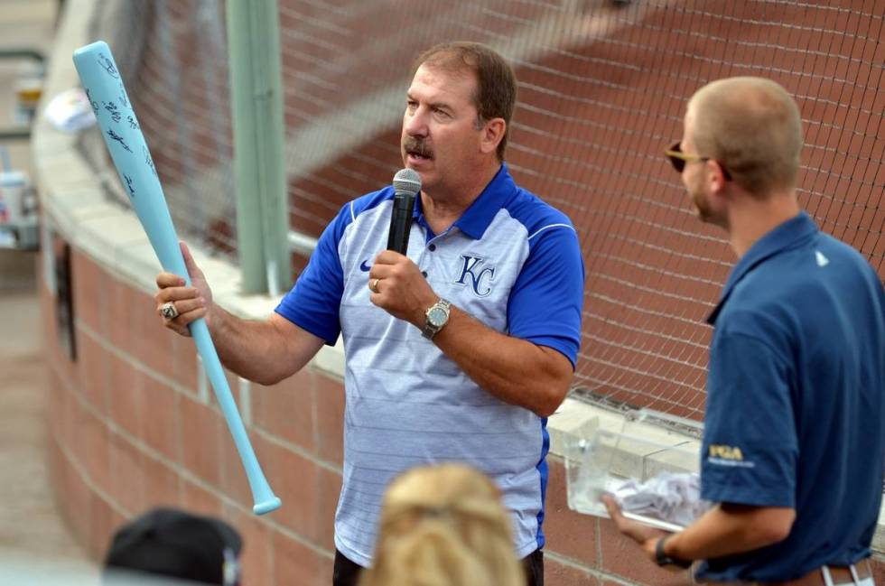 Kevin Greene, general manager of the Pioneer League's Idaho Falls Chukars, holds up an autograp ...