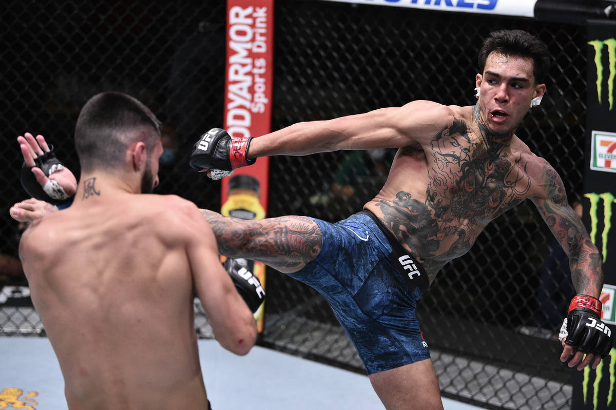 Andre Fili kicks Charles Jourdain of Canada in their featherweight fight during the UFC Fight N ...