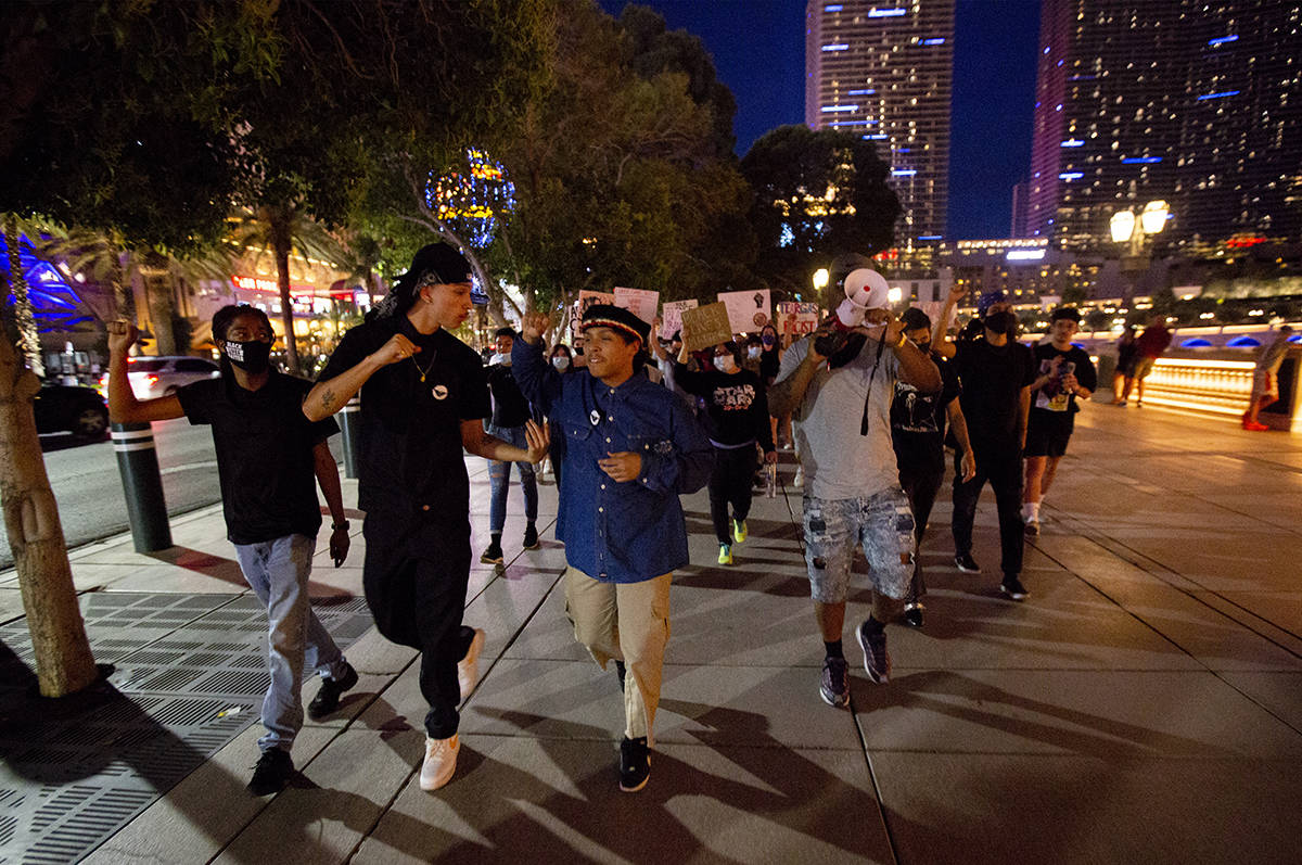 Protesters begin marching down the Strip starting at Bellagio in Las Vegas on Monday, June 15, ...