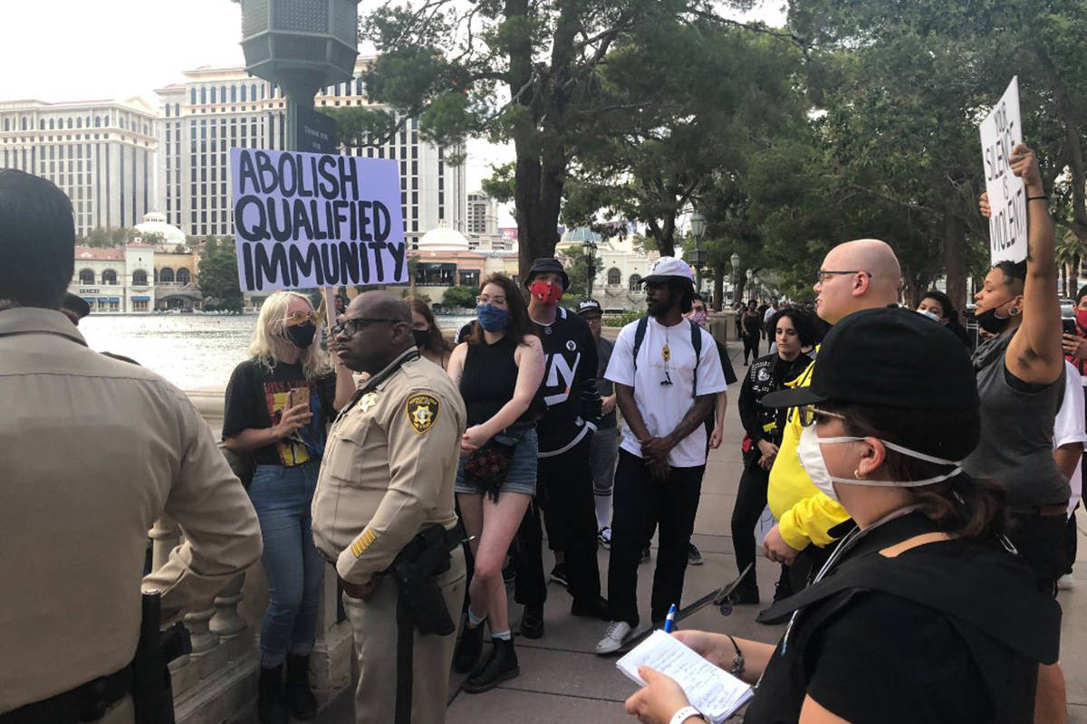 About 20 protesters gather Monday, June 15, 2020, outside Bellagio on the Las Vegas Strip. (Jam ...