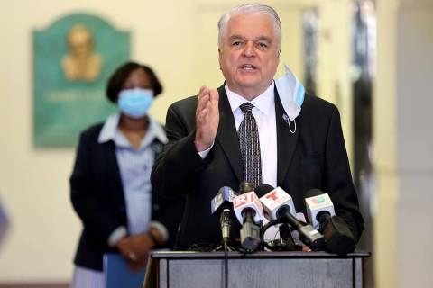 Gov. Steve Sisolak speaks as Assemblywoman Daniele Monroe-Moreno looks on during a press confer ...