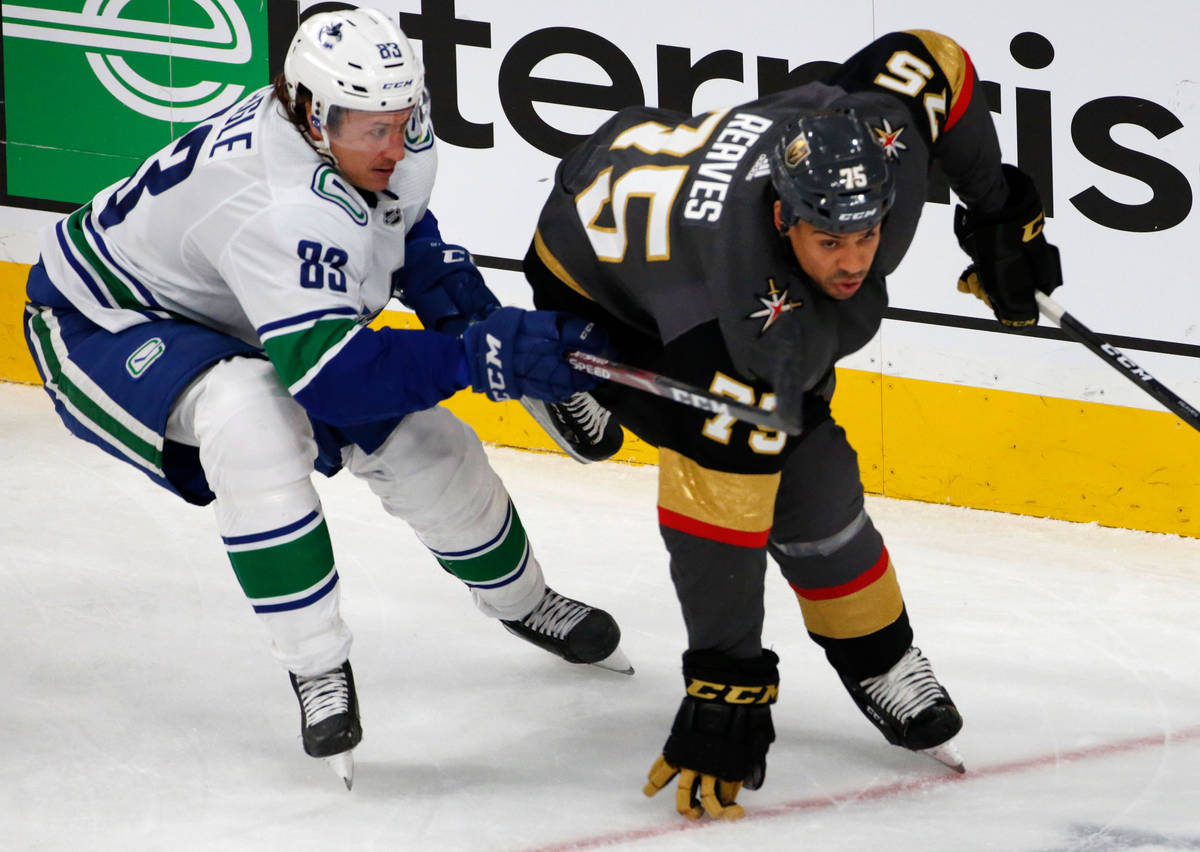 Vancouver Canucks center Jay Beagle (83) competes with Vegas Golden Knights right wing Ryan Rea ...
