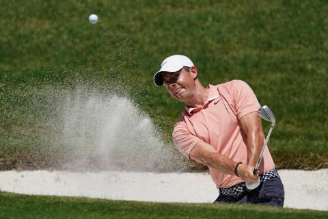 Rory McIlroy, of Northern Ireland, chips into the hole for a birdie on the 16th green during th ...