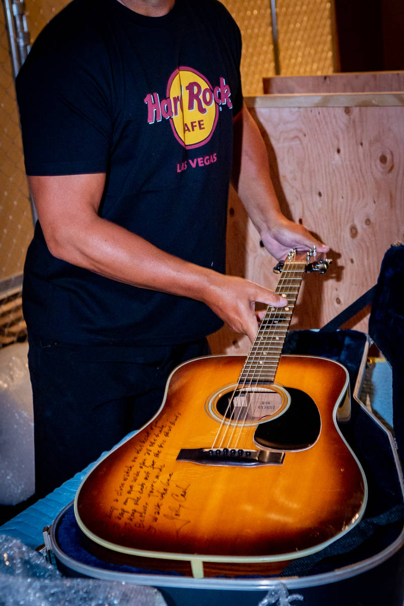 Johnny Cash's autographed Martin guitar is one of the items taken out of the Hard Rock Hotel ...