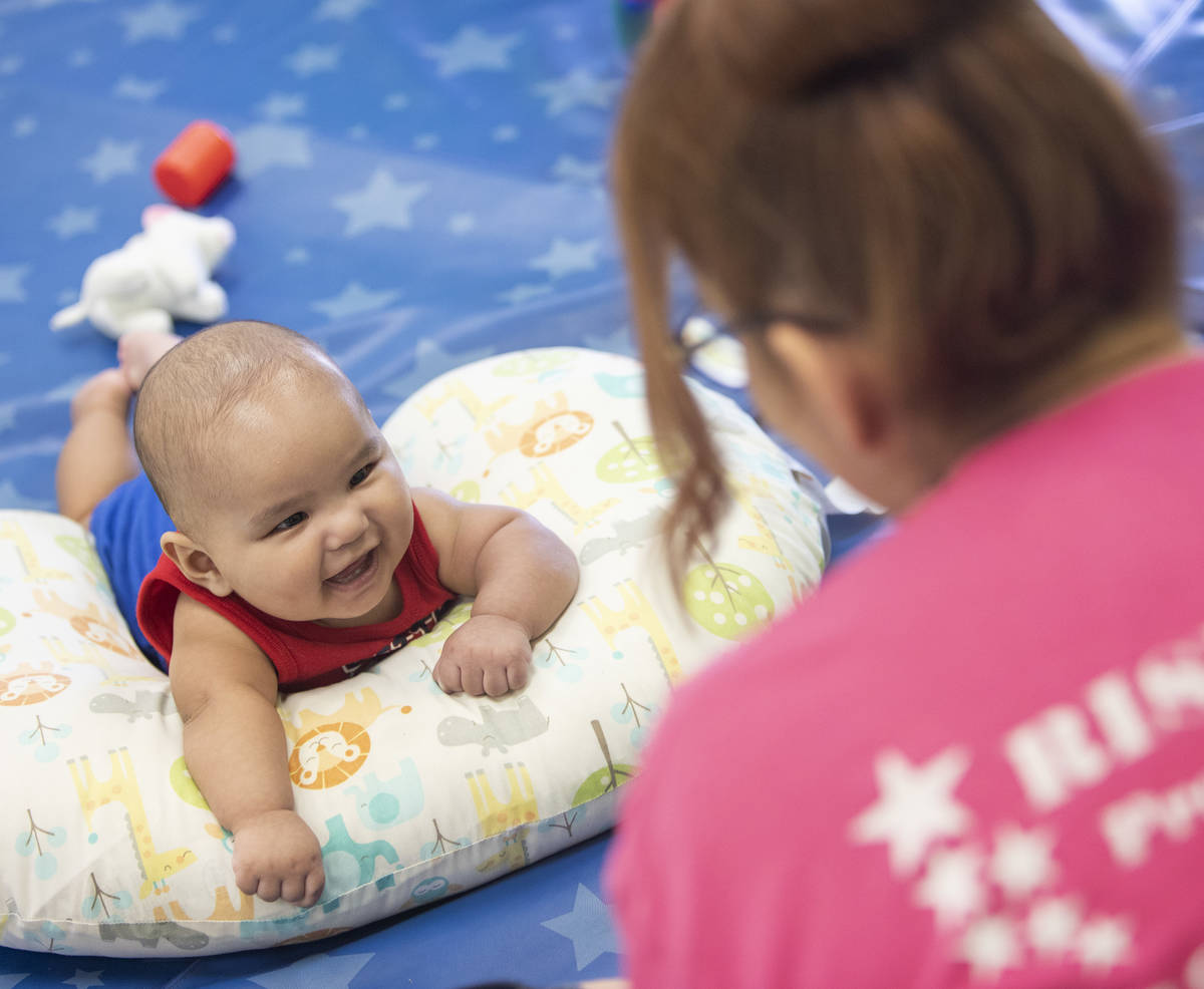 Lorenzo smiles at Miss Brenda at Rising Star Preschool & Childcare on Tuesday, June 16, 202 ...