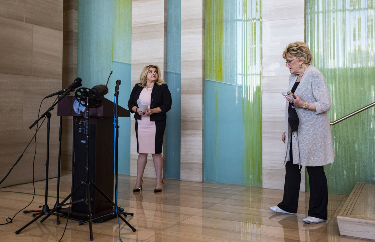 Las Vegas City Councilwoman Michele Fiore, left, looks on after a press conference announcing t ...