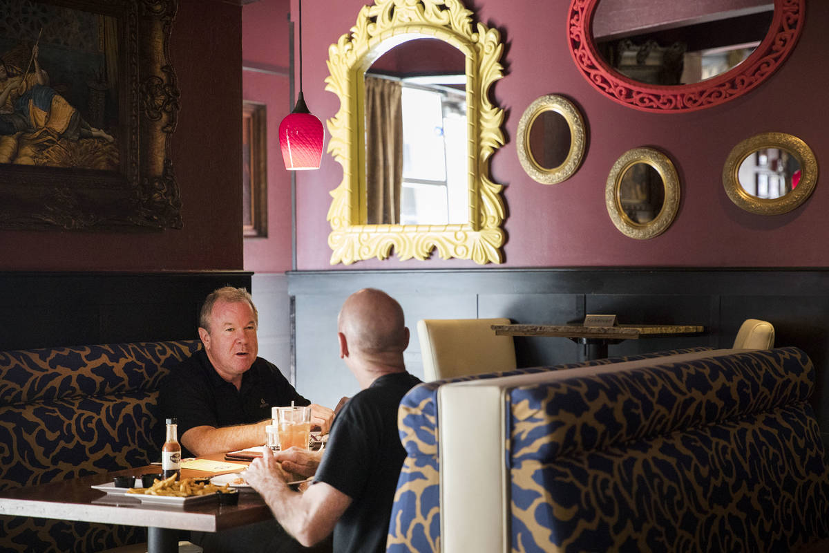 Andre Nelms, left, has lunch with Joe Giordano at Paymon's, a Mediterranean restaurant, in Las ...
