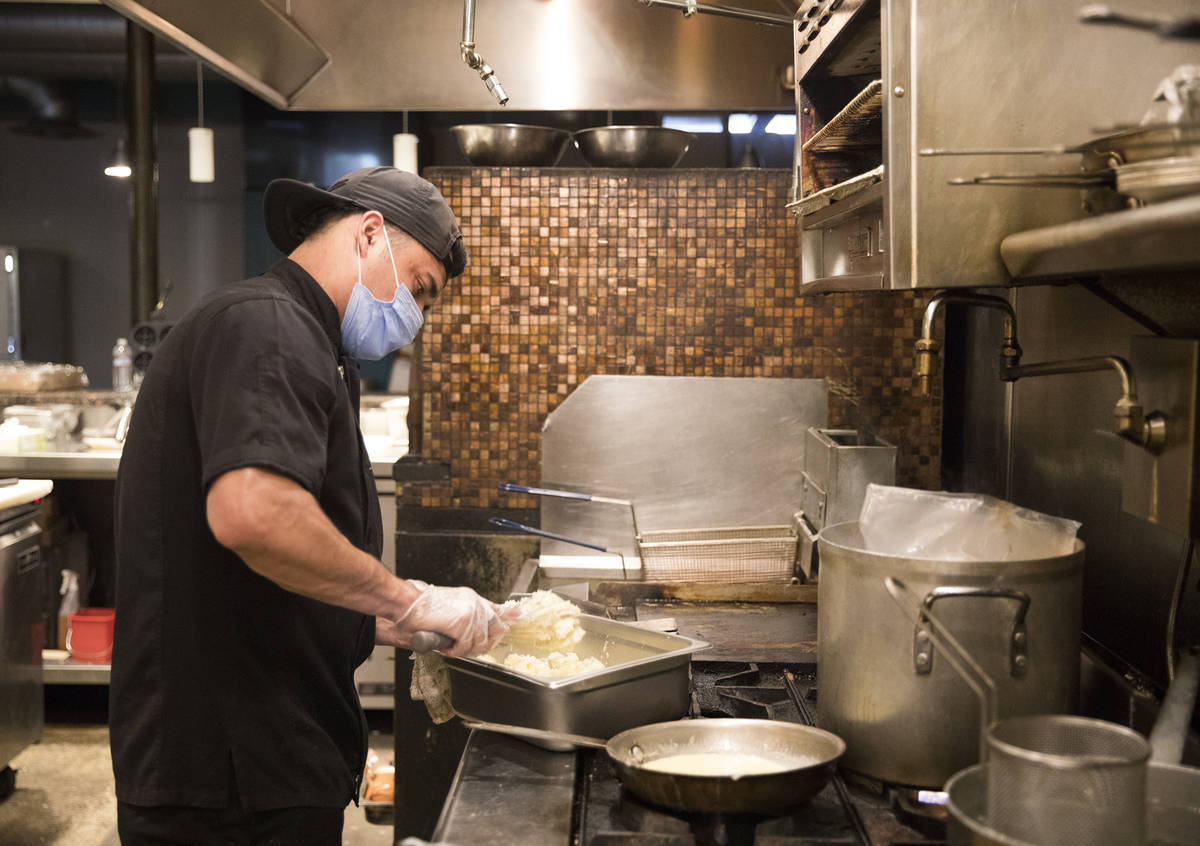 Jose Lopez works in the kitchen at 7th & Carson in Las Vegas, May 10, 2020. Restaurants hosted ...