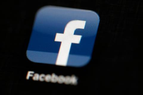 FILE - In this May 16, 2012, file photo, the Facebook logo is displayed on an iPad in Philadelp ...