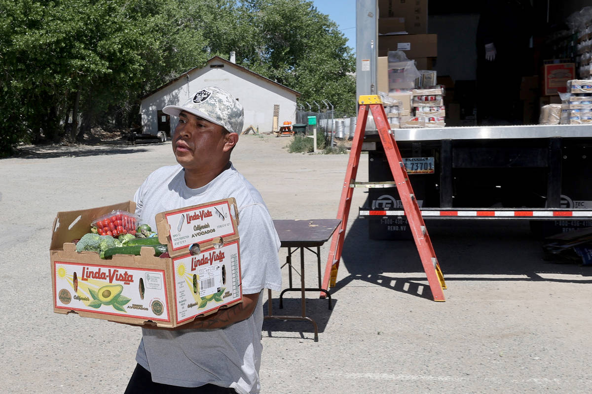 Tribal member Jake Bobb delivers food at Walker River Paiute Tribe's Walker River Indian Reserv ...