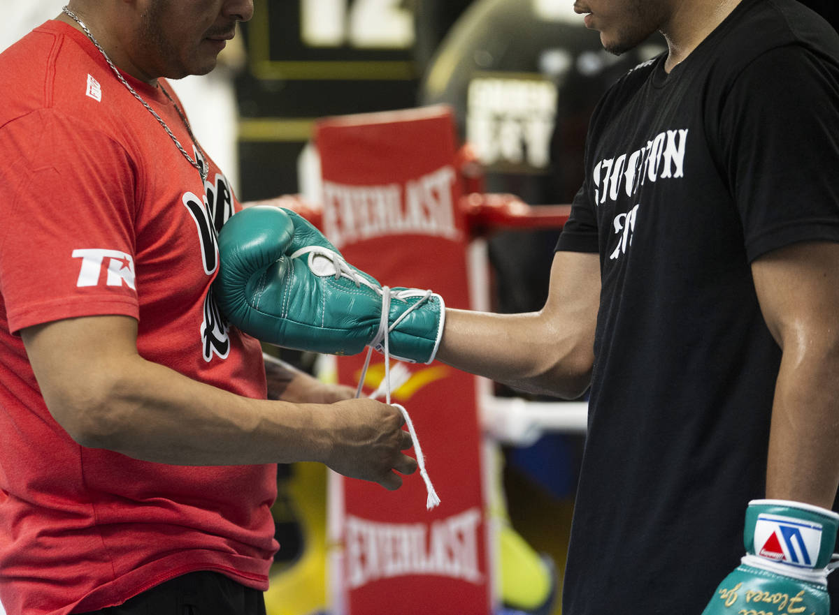 Gabe Flores Jr., right, prepares to work out with trainer and father Gabriel Flores Sr. at Cape ...
