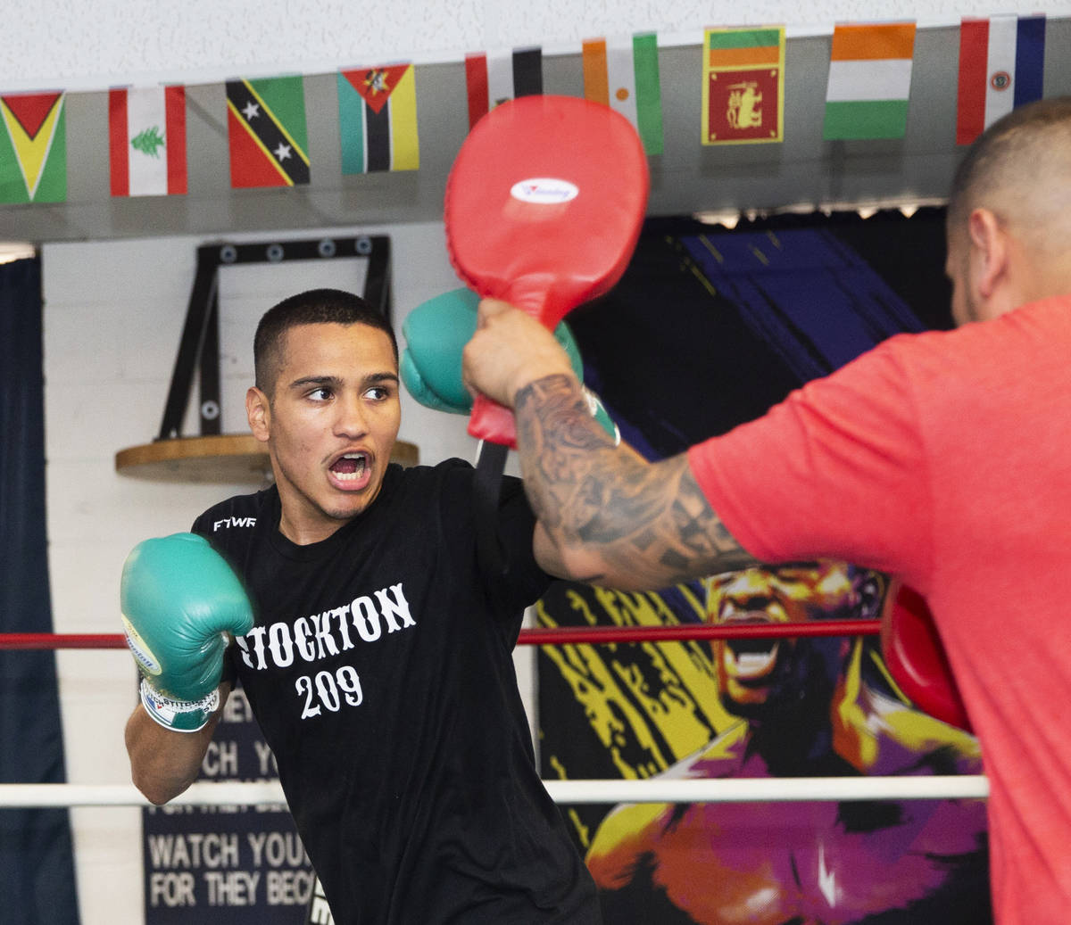 Gabe Flores Jr., left, works out at Capetillo & TM Boxing on Saturday, June 13, 2020, in La ...