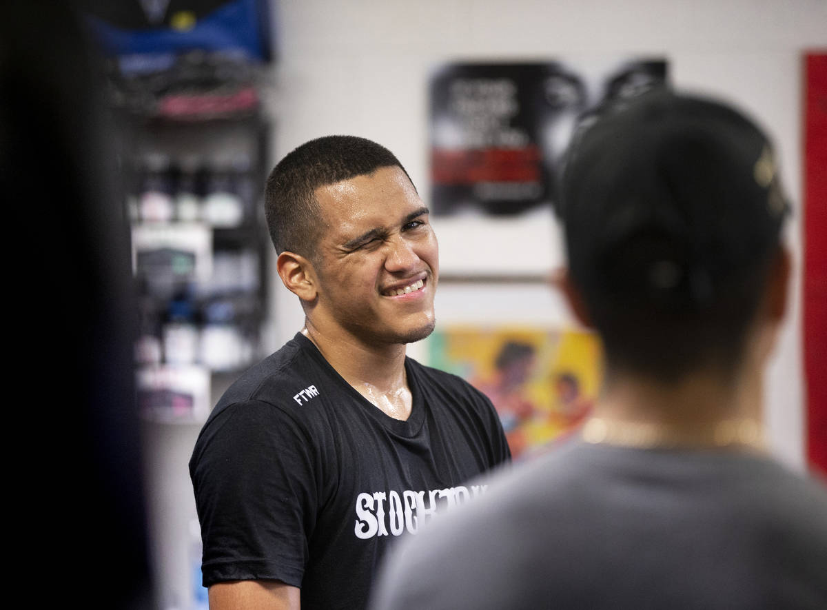 Gabe Flores Jr., left, jokes around with staff at Capetillo & TM Boxing on Saturday, June 1 ...