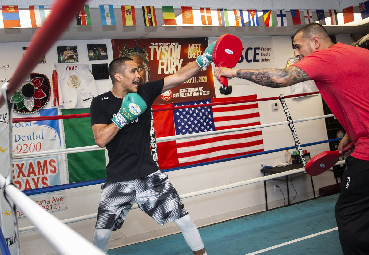 Gabe Flores Jr., left, works out with his trainer and father Gabriel Flores Sr. at Capetillo &a ...