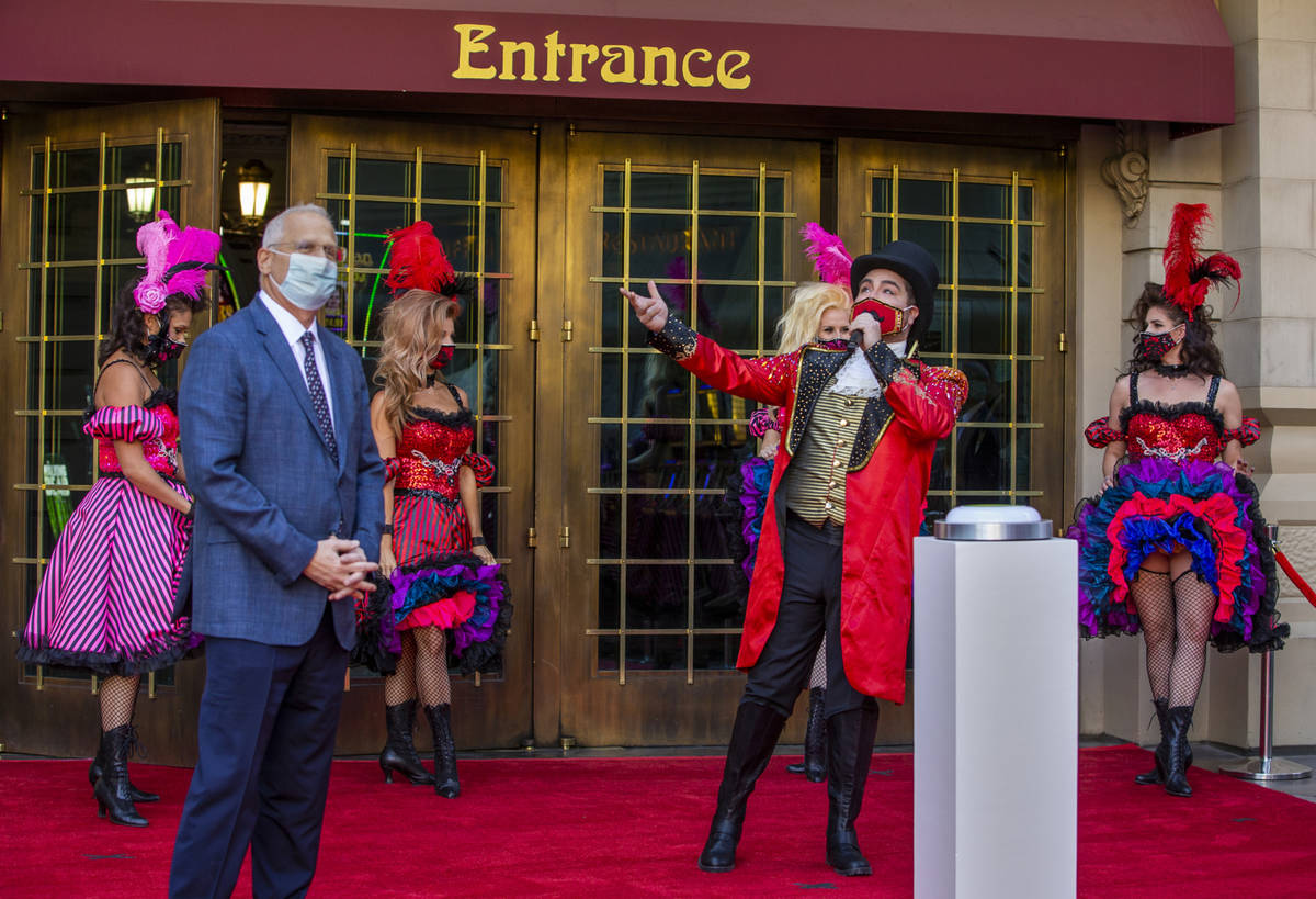 Paris Las Vegas Regional President Gary Selsner, left, looks on as a Monsieur Loyal ringmaster ...
