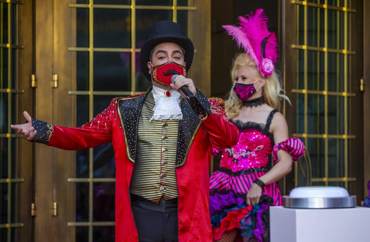 A Monsieur Loyal ringmaster greets those gathered outside the entrance of the Paris Las Vegas t ...
