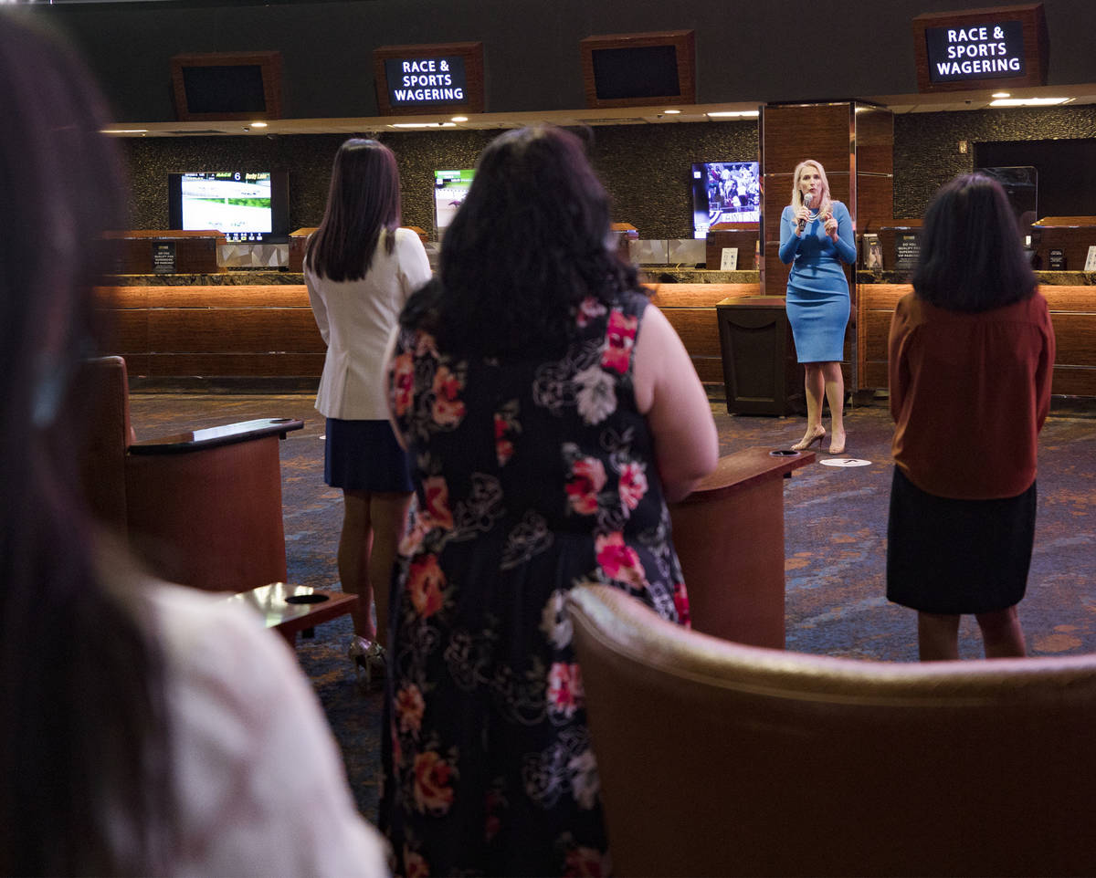 Cami Christensen, general manager and president of Westgate Las Vegas, addresses employees befo ...