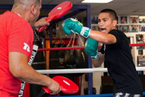 Gabe Flores Jr., right, works out with his trainer and father Gabriel Flores Sr. at Capetillo & ...