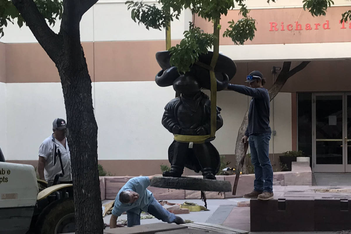 UNLV works to remove the Hey Reb! statue from in front of the Tam Alumni Center on Tuesday, Jun ...