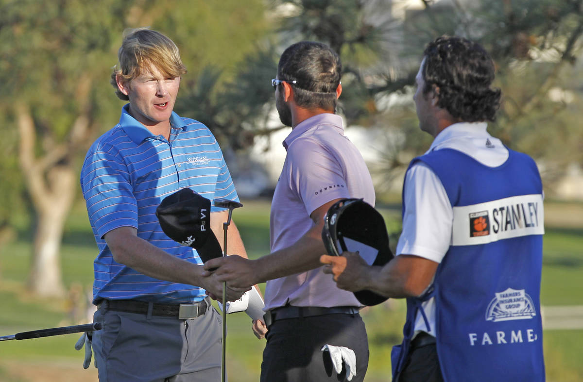 Brandt Snedeker, left, is congratulated by Kyle Stanley after beating Stanley on the second pla ...