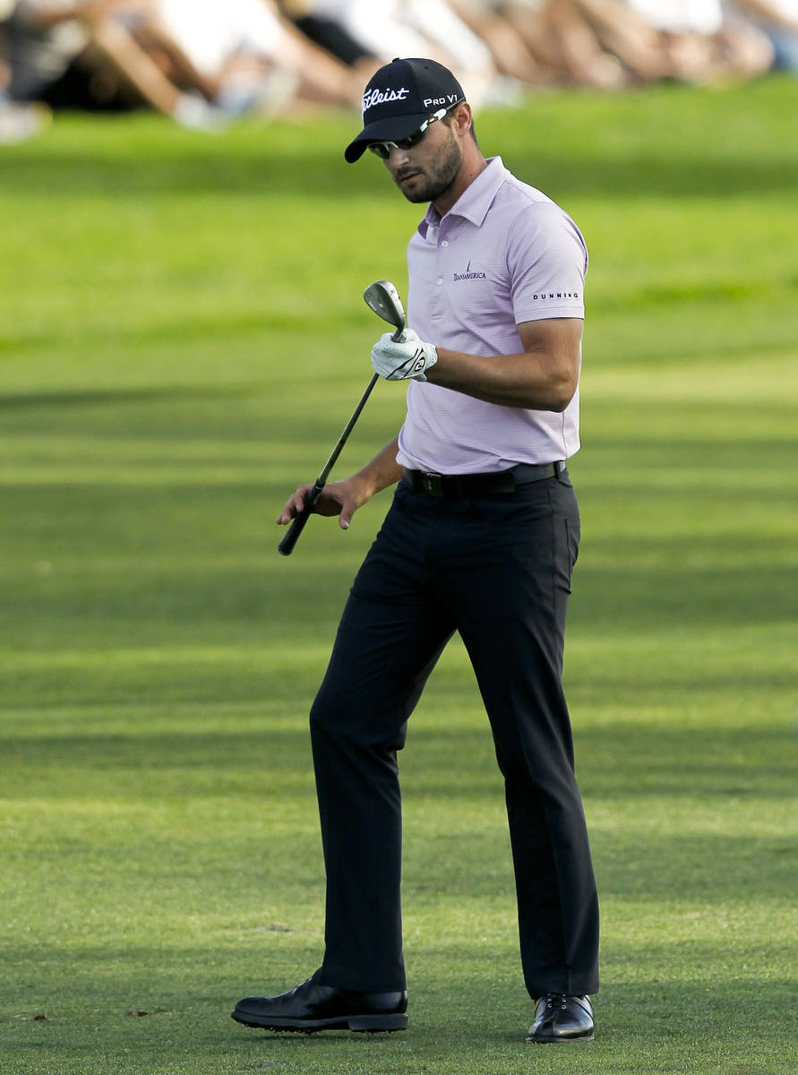 Kyle Stanley looks at his wedge after hitting into the water on the 18th hole during final roun ...