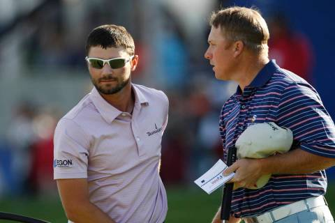 Kyle Stanley is consoled by John Rollins, right, after making a triple bogey on the 18th hole ...