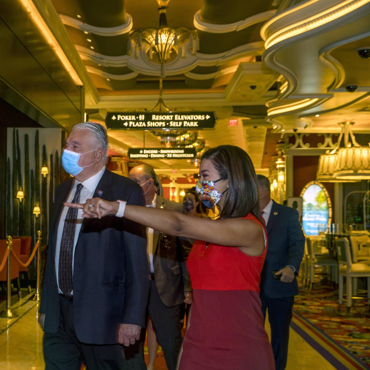 Gov. Steve Sisolak walks beside Sandra Morgan, chairwoman of the Nevada Gaming Control Board, a ...