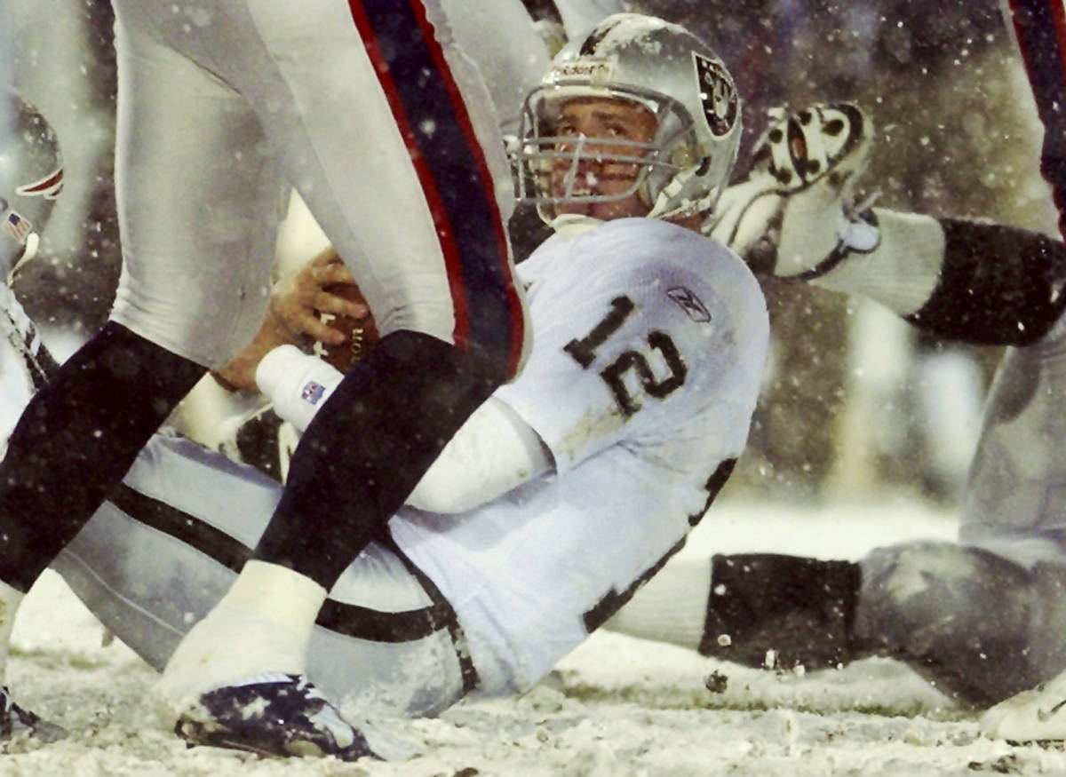 Oakland Raiders quarterback Rich Gannon looks up after he was sacked by the New England Patriot ...